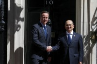 Britain's Prime Minister David Cameron greets the President Thein Sein in Downing Street, central London on 15 July 2013. (Reuters)