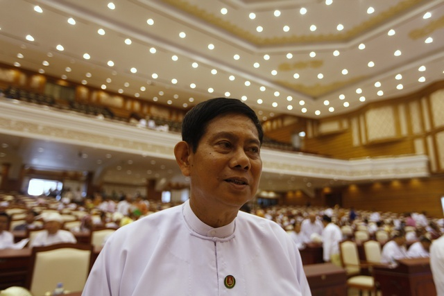Htay Oo talks to reporters before the Lower House parliament meeting in Naypyidaw on 23 April 2012. (Reuters)