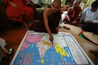 Buddhist monk Wimala Biwuntha displays a religion-focused map before a 969 conference in a monastery in Rangoon last year. (PHOTO: Reuters)
