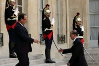 French President Francois Hollande (L) welcomes President of Burma Thein Sein as he arrives at the Elysee Palace in Paris on 17 July 2013. (Reuters)