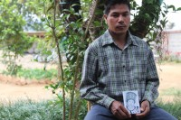 Kachin farmer Dau Lum holds a picture of his wife, who was abducted by the Burmese military more than 20 months ago. (Photo by Edward Chung Ho)