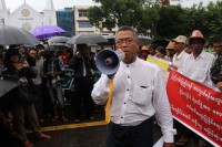 Win Cho at a protest against seized farmlands in front of Rangoon's City Hall on 9 July 2013. (DVB)