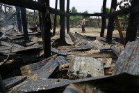 The shell of a burnt-out house is all that remains after a night of anti-Muslim riots in Htan Gone, Sagaing division.  (Reuters)