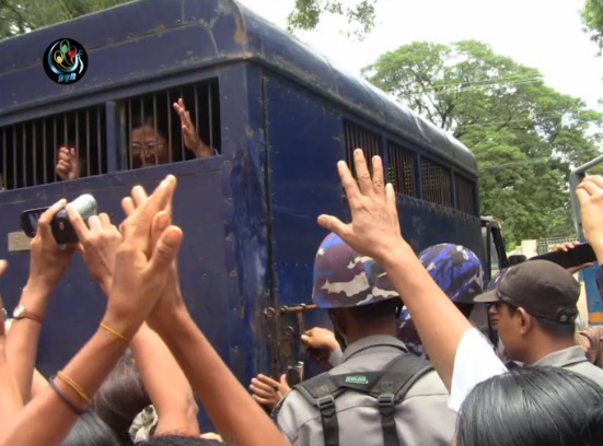 Latpadaung protestor Naw Ohn Hla is forcefully escorted to court in Monywa on Thursday, 29 August. 2013