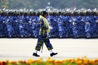 A guard of honour contingent marches during a parade to mark the 68th anniversary of Armed Forces Day in Burma's capital Naypyidaw. (Reuters)