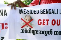 Demonstrators protested against the visit of Tomas Ojea Quintana, United Nations Special Rapporteur on Human Rights in Burma, when he visited Arakan State on 12 August 2013. (PHOTO: Reuters)