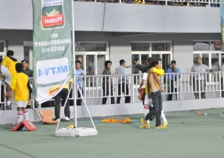 A fan attempts to rush the pitch during a Naypydiaw Football Club and Yangon United match in the capital on 4 August 2013. (MFF)
