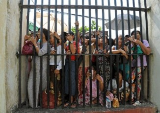 In this file picture from Insein prison in Rangoon, families of inmates await the release of their loved ones. (AFP)
