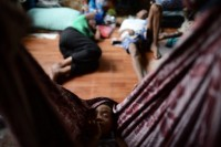 An HIV positive orphan sleeping in a hammock at a clinic in the outskirts of Rangoon (AFP)