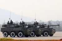 Military vehicles parade during the 68th anniversary of Armed Forces Day in Naypyidaw. (PHOTO: Reuters)