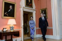 Britain's Prime Minister David Cameron leads Burmese opposition leader Aung San Suu Kyi on a tour of 10 Downing Street during the latter's visit to London on 23 October 2013. (AFP)