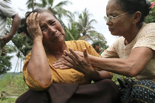 A Kaman Muslim woman cries in Sandoway, Arakan state, after the region was hit by a bout of religious clashes (AP)