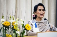 Burmese opposition leader Aung San Suu Kyi delivers a speech during a conference entitled 'Charity and compassion in Europe' at the UCL university in Louvain-la-Neuve, on October 19, 2013. (AFP PHOTO)