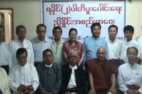 Members of Arakan State's two largest political parties, the ALD and the RNDP, pictured at a ceremony in Rangoon in June when theymerged to form the Arakan National Party. (PHOTO: DVB)