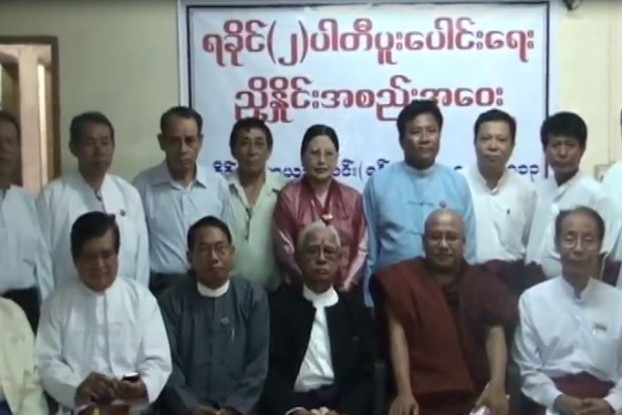 Members of Arakan State's two largest political parties, the ALD and the RNDP, pictured at a ceremony in Rangoon in June 2013 when they merged to form the Arakan National Party. (PHOTO: DVB)