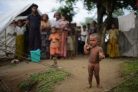A Rohingya child cries outside a displacement camp in Sittwe, Arakan state (AFP)