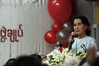 In this file photo, opposition leader Aung San Suu Kyi delivers a speech at the National League for Democracy (NLD) headquarters in Rangoon, September 2013 (AFP)