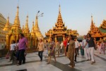 Tourists walk around the famed Shwedagon Pagoda in Rangoon. (PHOTO: AFP).