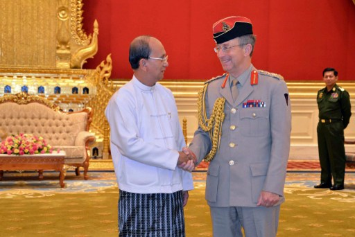 President Thein Sein shaking hands with Britain's top military chief General David Richards in Naypyidaw (AFP)