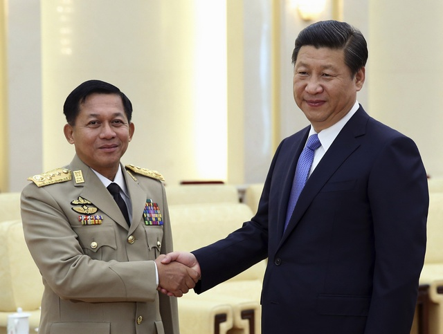 China's President Xi Jinpin, right, shakes hands with Burma's Commander-in-Chief  Snr-Gen Min Aung Hlaing in Beijing on 16 October 2013. (Photo: Reuters)