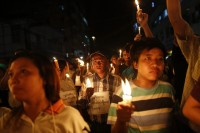 File Photo: Demonstrators held a candlelight vigil in Rangoon in 2013 to protest a proposed hike in energy prices. (PHOTO:REUTERS)