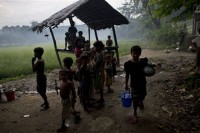 In this file picture from 2013, Muslim children gather at a well in northern Arakan's Maungdaw township. (PHOTO: AP)