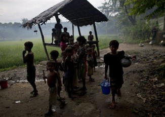 In this file picture from 2013, Muslim children gather at a well in northern Arakan State's Maungdaw Township. (Photo: AP)
