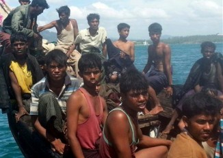 File photo from 2013 of Rohingya refugees sitting in a boat as they are intercepted by Thai authorities off the sea in Phuket, southern Thailand. (PHOTO: AP)