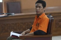 Suspected militant Separiano sits on the defendant's chair during his trial in South Jakarta District Court in Jakarta, Indonesia, 6 November 2013. (AP)