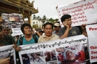 Moe Thway (L) and Aung Soe (C), leaders of demonstrators peacefully protesting against the Latpadaung Copper Mine, march near Shwedagon Pagoda before being arrested by police in Rangoon on 2 December 2012. (Reuters)