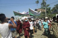 "Thousands of Arakanese Buddhists marched in several of townships on 16 March, demanding that the term ""Rohingya"" be omitted from census data collection. In this photo, demonstrators in the state capital, Sittwe, carry banners reading, ""We won't give in to international pressure"". (PHOTO: Democratic Party of Arakan)"