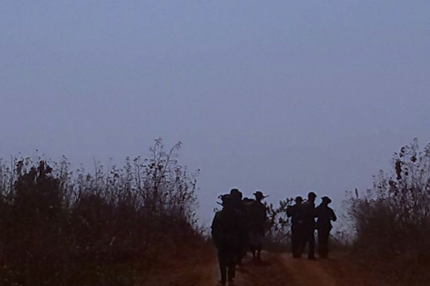 In this file photo, Burmese soliders leave Wan Kai Ak village in Shan State on 5 March 2014. (PHOTO: SHRF)