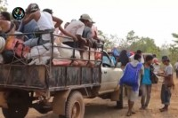 Thameelay villagers, evicted from their homes in Rangoon, are escorted in trucks by the DKBA to a new site in Kyaukkhet in Karen State. (PHOTO: DVB)