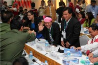 TNLA Chairman Tar Aik Bong (pink headscarf) is pictured greeting military delegates at the ceasefire negotiations in Rangoon on Saturday, 5 April 2014. (PHOTO: DVB)