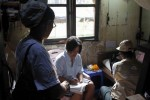 A census enumerator takes answers from a family in Rangoon, April 2014. (PHOTO: DVB)