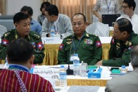 Burmese military officers representing the UPWC chat ahead of peace talks with ethnic groups at the Myanmar Peace Center in Rangoon on the morning of Wednesday, 21 May 2014. (PHOTO: DVB)