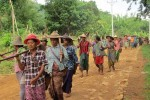 "FILE PHOTO: Karenni farmers march to the fields that were confiscated from them 10 years ago in a ""ploughing protest"" on Tuesday, 27 May 2014, in Hpruso, near state capital Loikaw. (Photo: DVB)"