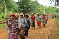 "Karenni farmers march to the fields that were confiscated from them 10 years ago in a ""ploughing protest"" on Tuesday, 27 May 2014, in Hpruso, near state capital Loikaw. (PHOTO: DVB)"