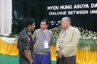 On the sidelines of peace talks in Myitkyina on Tuesday, 13 May 2014, (left to right): Maj-Gen Gun Maw, Aung Min and Myanmar Peace centre's Hla Maung Shwe.