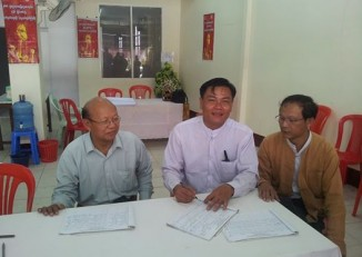 Nay Myo Zin, middle, pictured in the National League for Democracy office on 25 June 2014. (PHOTO: Nay Myo Zin Facebook)