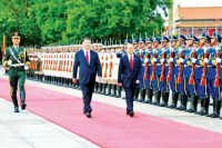 Burma's President Thein Sein (right) walks with his Chinese counterpart, Xi Jinping, as he arrives to a guard of honour at Beijing Airport on Friday, 27 June 2014. (PHOTO: NLM)