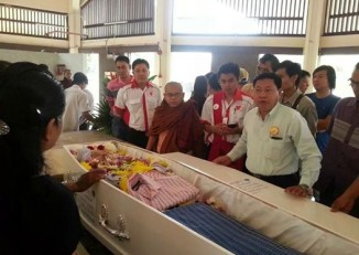 The funeral of Tony on 9 July in the town of Jinjan in Malaysia. Myo Paing, centre, white shirt, was killed later that same day. (PHOTO: Sakhunna Ung)