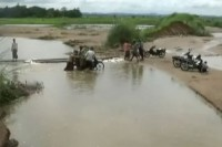 In this file photo, flooding caused by spillover from a nearby reservoir in Thegon, Pegu Division in late July 2014. (PHOTO: DVB TV)