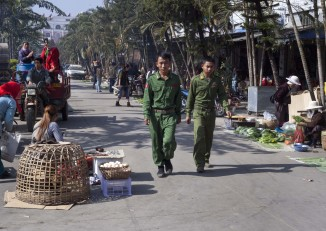 Soldiers from National Democratic Alliance Army (NDAA) walking in the Mong La market in Shan State's Special Region Four, also known as Mong La (PHOTO: Seamus Martov).