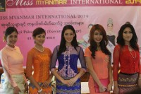 Khin Wai Phyo, 18, (middle) poses with other contestants in the Miss Myanmar International competition in Rangoon on 19 August 2014. (PHOTO: DVB)