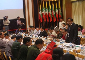 In this file photo, NCCT Vice-Chairman Nai Hongsa addresses delegates at talks between the UPWC (left) and the ethnic alliance NCCT (right) in Rangoon, August 2014. (PHOTO: DVB)