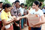 Burmese actress Thinzar Wint Kyaw delivers relief supplies to a mother and her baby in Hlegu on 12 August 2014. (PHOTO: DVB)