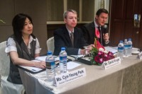 The ADB's Cyn-Young Park, David Kruger, and Winfried Wicklein at a press conference in Rangoon on 11 September 2014. (PHOTO: Alex Bookbinder/DVB)