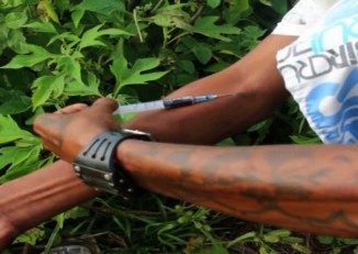 In this file photo, a man shoots heroin in northern Shan State. (PHOTO: DVB)