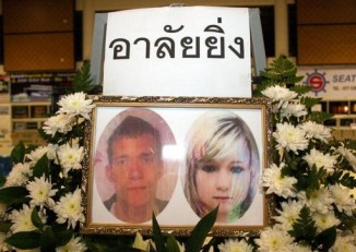 Passport photos of David William Miller and Hannah Victoria Witheridge were placed on this memorial on Koh Tao on Wednesday. (PHOTO: Supapong Chaolan)
